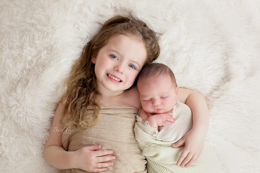 sibling shot newborn