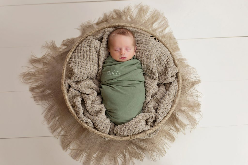 newborn boy in basket