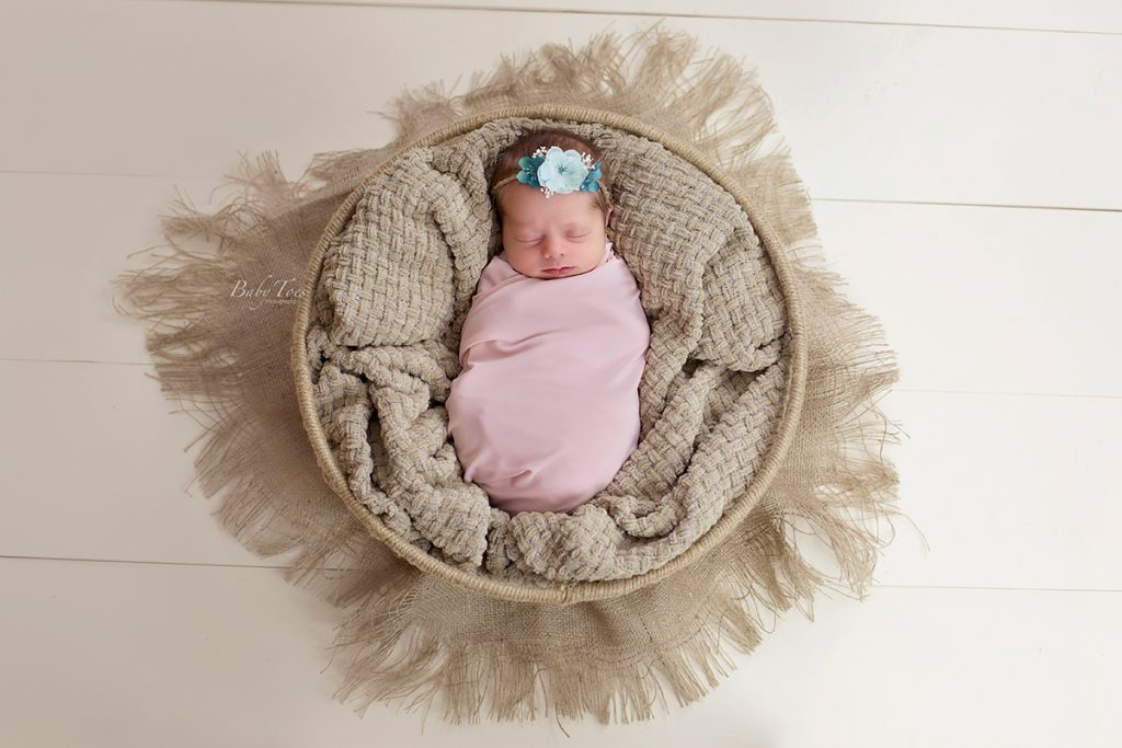newborn girl in basket
