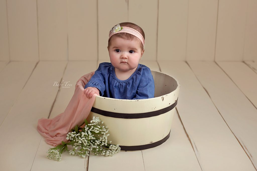 six month old baby in bucket